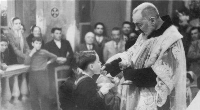 Padre Pio giving out communion