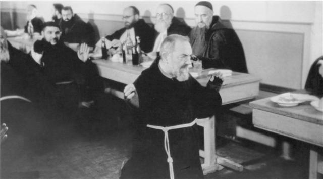 Padre Pio prating in refectory