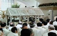 The friars passing the coffin