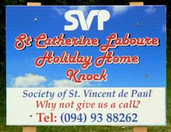 St. Catherine Labouré Holiday Home sign
