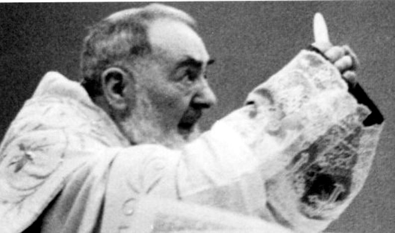 Padre Pio holding the host
